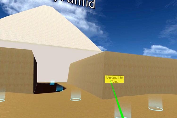 """Digitale Rekonstruktion des Eingangs, der in das Grab des Psamtik führt. Durch hellblaue Kreise sind die """"Schritte"""" vorgegeben, die Benutzer nehmen können. Die architektonischen Elemente sind als einheitliche Farbblöcke voneinander abgegrenzt. Der Boden ist hellbraun, die Mauern, die das Areal umgeben, sind braun und die Pyramide weiß."""
