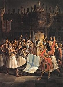 Das Gemälde von Theódoros Vryzákis zeigt den Bischof Germanos III. in einem goldenen Gewand in einer Kirche stehend. Um ihn herum stehen Männer in griechischer Tracht. Einer kniet vor dem Bischof nieder und hält die Fahne Griechenlands in den Händen, die vom Bischof geweiht wird. Die auf dem Gemälde gezeigte Szene ist teil des Freiheitskampfes ab 1821, der u.a. im Achilleion auf Korfu in einer Ausstellung thematisiert wird.