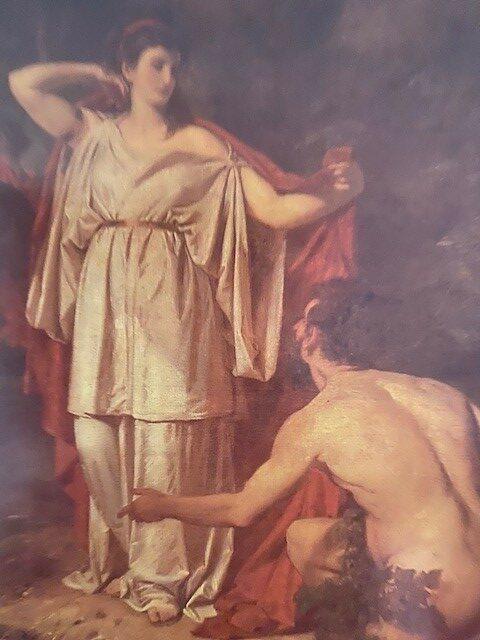 Nasikaa, in einem langen weißen Gewand und einem roten Manteltuch über den Schultern, steht vor Odysseus. Dieser kniet rechts zu ihren Füßen und schaut zu ihr hinauf.
